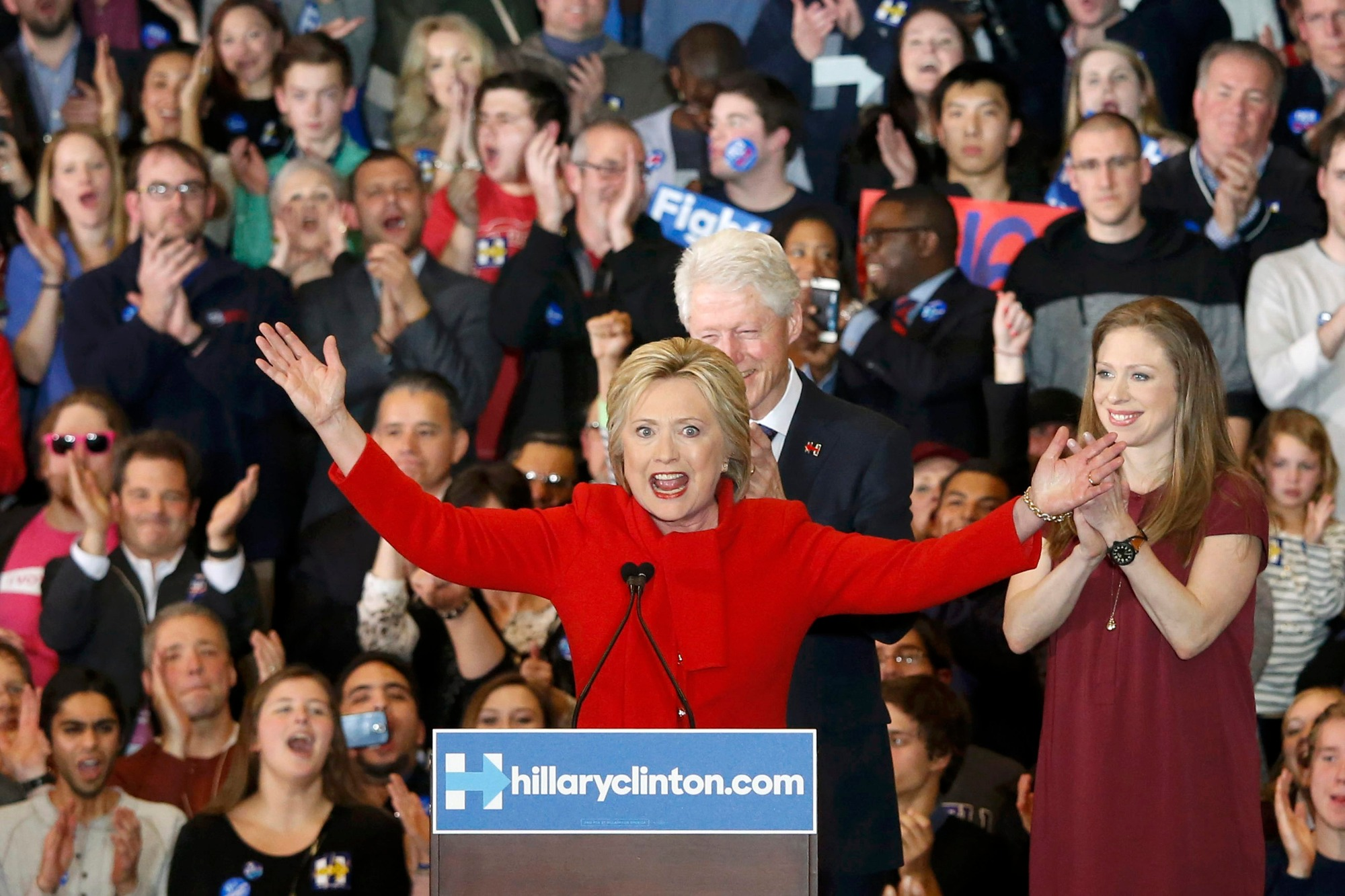 Former U.S. President Bill Clinton (rear) applauds his wife, Democratic U.S. presidential candidate Hillary Clinton, as they appear with their daughter Chelsea (R) at Mrs. Clinton's caucus night rally in Des Moines, Iowa February 1, 2016.     REUTERS/Adrees Latif